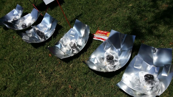row of solar cookers