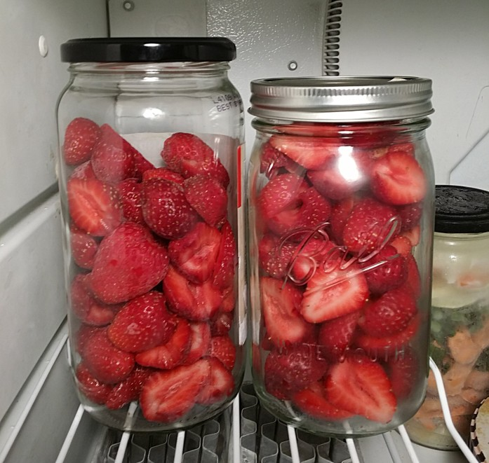 strawberries in jars
